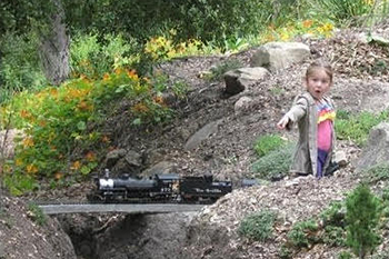 A child marvels at a model train during a previous Railroad Days. Occurring on the grounds of Gary and Marilyn Siegel's Montecito residence, the weekend-long event will benefit Parkinson Association of Santa Barbara.