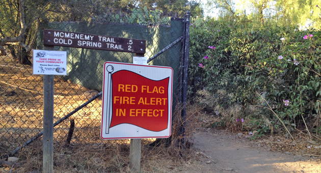 A 'red flag warning' is posted at the Cold Spring trailhead in Montecito on Tuesday, as forecasters were warning that a storm system moving through the Central Coast could bring dry lightning and an increased threat of wildfire. (Bill Macfadyen / Noozhawk photo via iPhone)