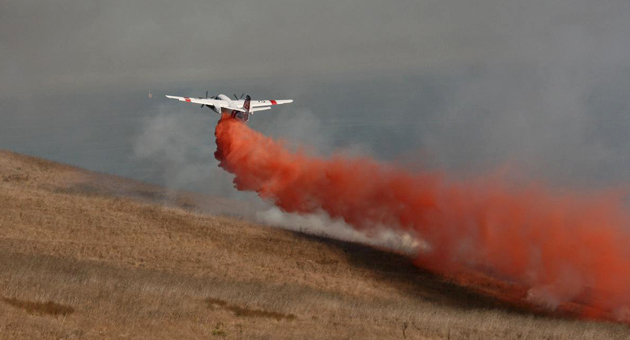 An air tanker drops a load of fire retardant on a blaze that was burning Monday afternoon near Refugio Canyon. The blaze was declared contained at 7 p.m. (Santa Barbara County Fire Department photo)
