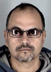 Robert Guzman, seen here in a 2011 booking photo provided by the Santa Barbara County Sheriff's Department, was shot and killed by Santa Maria police officers after he threatened them with a knife.