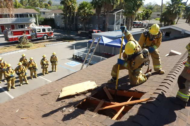Santa Barbara City Fire crews tore holes in the roof of the Sandman Inn as part of a training exercise for new recruits. The inn is preparing for demolition and construction of a new condo development.