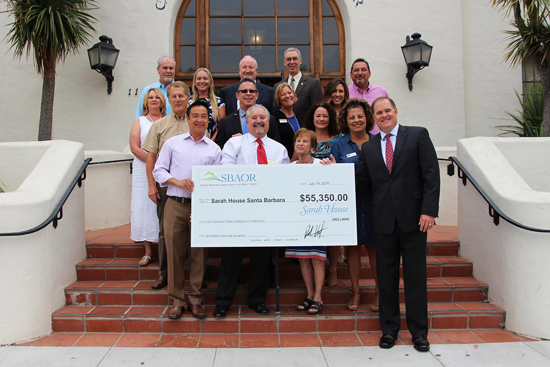 Members of the Santa Barbara Association of Realtors presents Sarah House staff with funds raised at the 7th Annual Charity Golf Tournament.