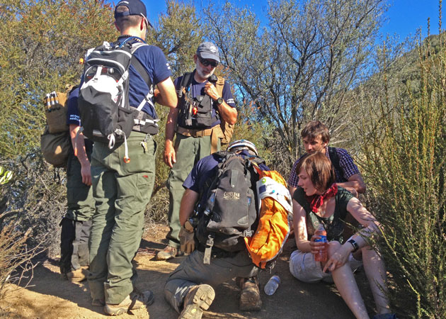 <p>Personnel from Santa Barbara County Search &amp; Rescue tend to an injured hiker on a recent call. A new program will place team members and other volunteers on trails and at trailheads during period of high fire danger.</p>