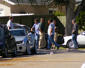 Sheriff's investigators look for evidence at the corner of Andrita and Rosemead streets near San Marcos High School following an incident in which a suspect was shot and critically wounded by deputies early Saturday. (Tom Bolton / Noozhawk photo)