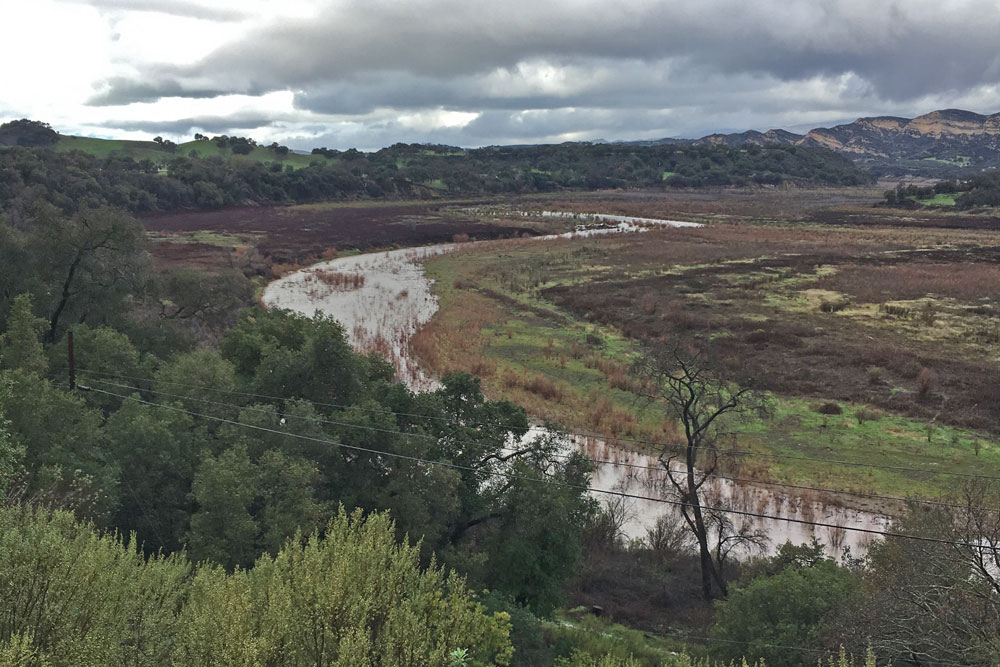 Recent storms cause minor flow from the Santa Ynez River into Lake Cachuma. Officials say a trio of storms expected to hit the region over the next several days could result in 'substantial inflow to Cachuma for the first time since 2011.'