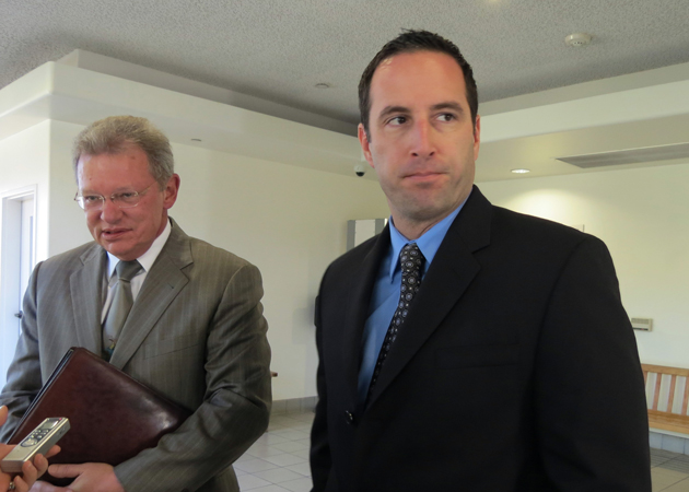 <p>Former Santa Barbara police officer Brian Kenneth Sawicki, right, leaves court Wednesday after being acquitted on lewd-conduct charges, but being found guilty on related counts. With him is his attorney, Michael Scott.</p>
