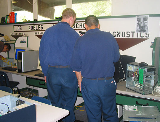 As part of their rehabilitation at Los Prietos Boys Camp, boys fix computers using donated parts, erase the hard drives and then install operating systems and educational programs for the Santa Barbara County Education Office's Computers for Families program.
