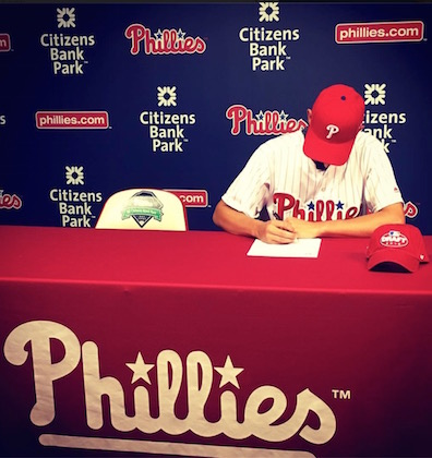 Kevin Gowdy signs his first ever pro contract with the Philadelphia Phillies on Wednesday  afternoon.