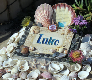 A small memorial has been built at Surf Beach near Lompoc in honor of Lucas Ransom, who was killed there two years ago by a great white shark. A surfer died at Surf Beach Tuesday in what officials say was a shark attack. (Gina Potthoff / Noozhawk photo)