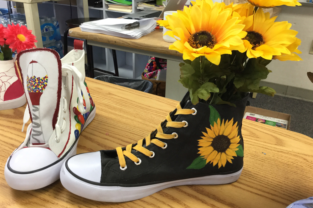 Dona Kintzi's Orcutt Academy High School students turned shoes into artwork to be auctioned off at Shoes for Students fundraiser Sunday in Santa Maria.