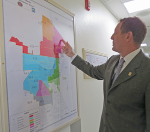 Santa Maria Fire Chief Dan Orr looks over a map of fire service areas in the city. The Fire Department's Station No. 5 opened full time on Monday, which officials said should help improve response times. (Gina Potthoff / Noozhawk photo)