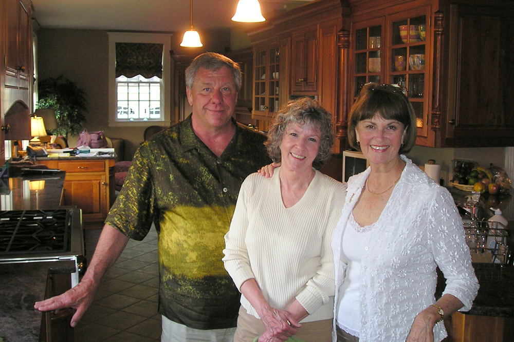 Sue Grafton, center, stands with her husband Steve Humphrey and longtime friend Susan Miles Gulbransen at Grafton's Louisville home, in this undated photo.