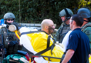 Paul Robinette, 43, of Oxnard is loaded into an ambulance Wednesday after deputies subdued him in Montecito. Robinette, who had threatened to kill himself, was involved in an hours-long standoff. (Lara Cooper / Noozhawk photo)