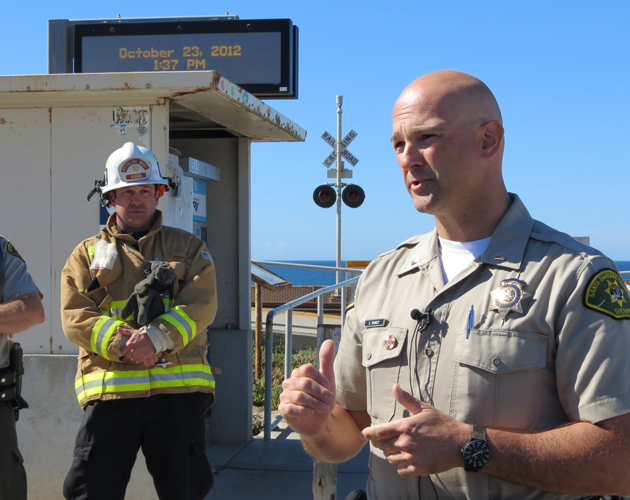 Santa Barbara County sheriff's Lt. Erik Raney briefs reporters Tuesday at Surf Beach near Lompoc after a 39-year-old surfer was fatally injured in a shark attack. (Gina Potthoff / Noozhawk photo)
