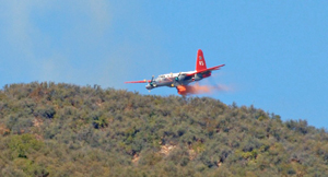 A tanker drops a load of fire retardant Tuesday on the Cold Fire above Montecito. (Gary Lambert photo)