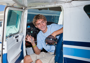 A teen flier is all smiles after taking his first flight aboard a private aircraft. (Lynn Houston / A Different Point of View photo)