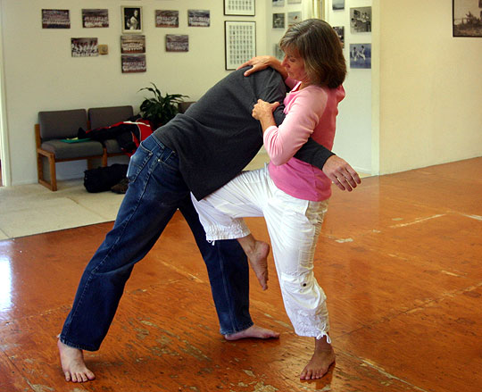 Teri Coffee McDuffie, founder of Santa Barbara Women's Self-Defense, demonstrates a knee strike. No matter your age or ability, martial arts training is good for exercise, confidence and protection.