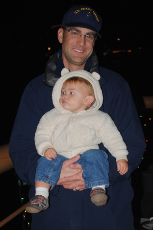 Coast Guard Chief Petty Officer Terrell Horne holds his son during a Christmas cruise onboard the Cutter Halibut in this undated photograph. Horne was killed early Sunday when his boat was rammed by suspected drug smugglers near Santa Cruz Island, according to the Coast Guard. (Contributed photo)