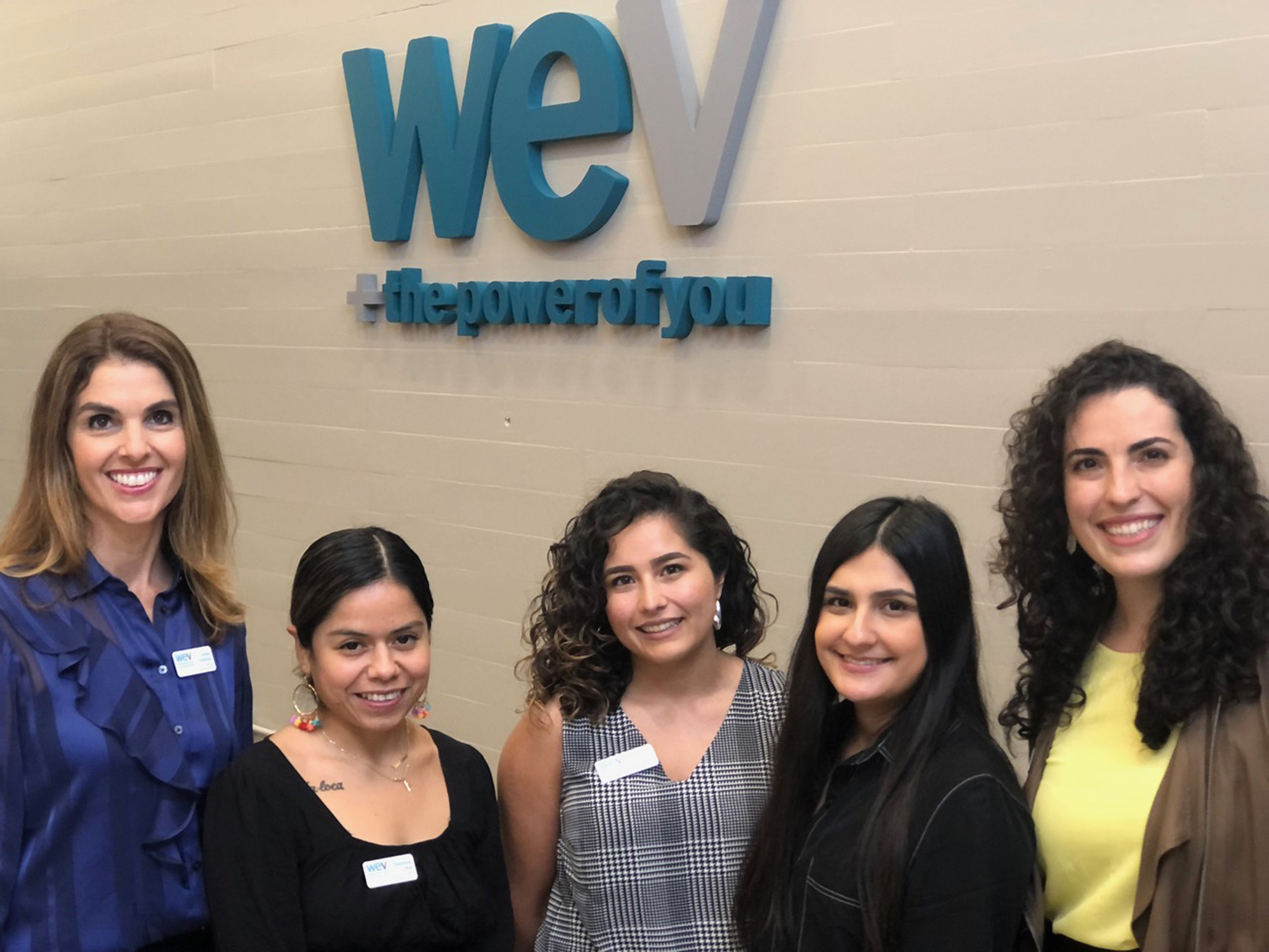 WEV staff members gather for the open house.