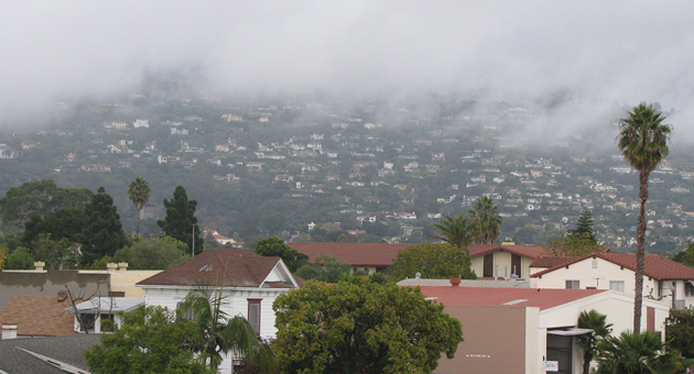Rain clouds skim across the Riviera above Santa Barbara Friday, as the area continued to receive showers from a series of storms moving through the region. (Giana Magnoli / Noozhawk photo)