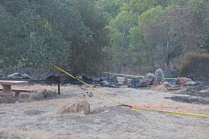 Yellow tape marks off the area near the White Rock day-use area where authorities believe the White Fire started Monday afternoon. Reports that the blaze started when someone dumped hot coals could not be confirmed, and the investigation was continuing Tuesday. (John Palminteri / KEYT News photo)