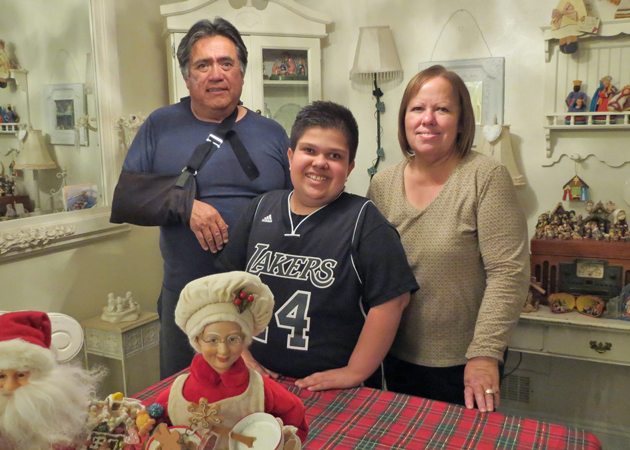 Jason Melena Flores and his grandparents, Bob and Stephanie Melena, will flip the switch to light up Santa Maria's first Christmas tree. (Gina Potthoff / Noozhawk photo)
