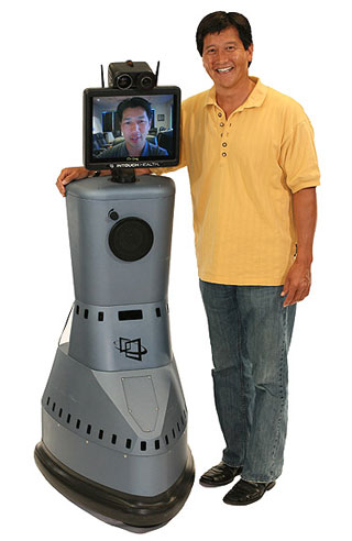 InTouch Health founder and CEO Yulun Wang and the company's signature robot, which allows a surgeon to diagnose and treat patients anywhere and anytime.