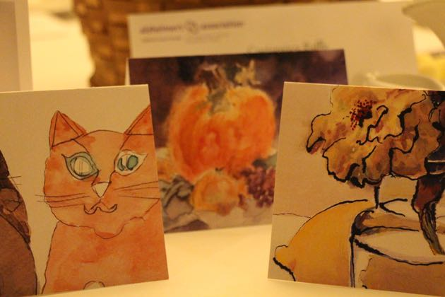 Decorative cards made by people living with Alzheimer's disease graced the tables.