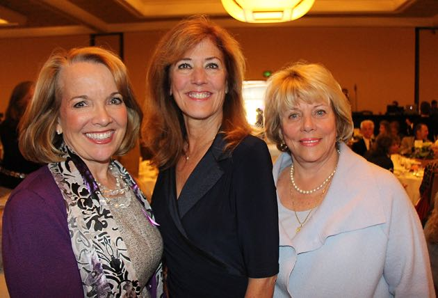 From left, table sponsor Leigh Cashman of State Farm Insurance's Team Cashman, Mindy Denson and Penny Jenkins.