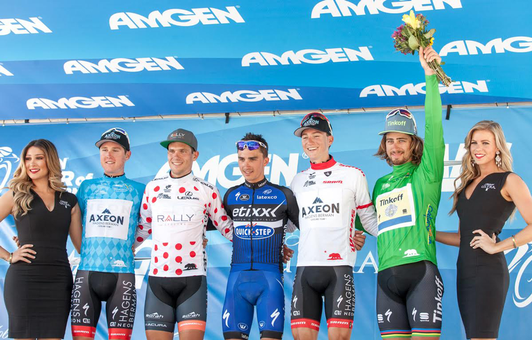 Gregory Daniel, Evan Huffman, Julian Alaphilippe, Neilson Powless and Peter Sagan celebrate at the Stage 3 finish line with Michelob Ultra Podium Ambassadors Joanna Zanella and Allison Steinkamp.