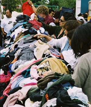 Shoppers browse the clothing section at last year's UCSB GIVE Project sale. (UCSB GIVE Project photo)