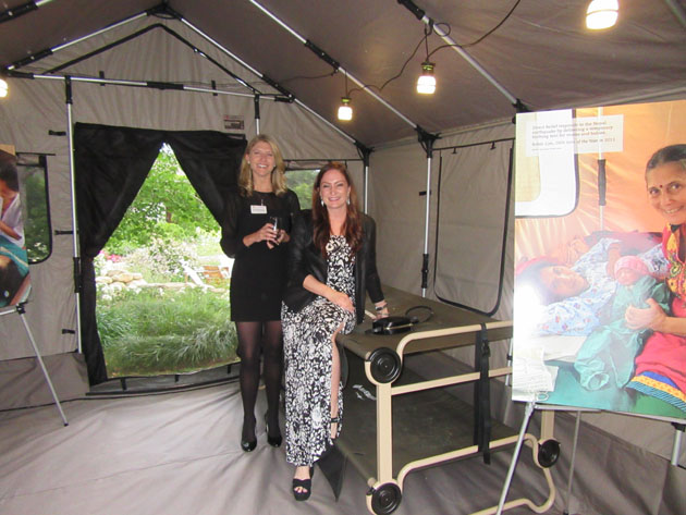 Direct Relief staff members Lindsey Fry, left, and Jessica Koval show off a birthing tent.