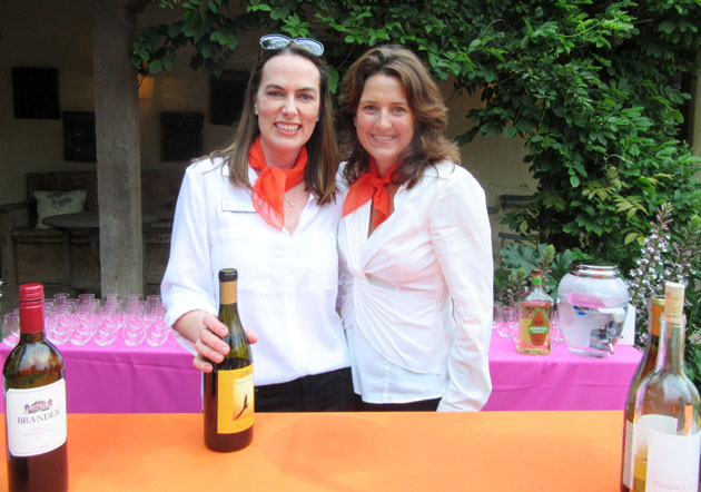 Volunteer bartenders Angela Siemens, left, and Allison Marcillac.