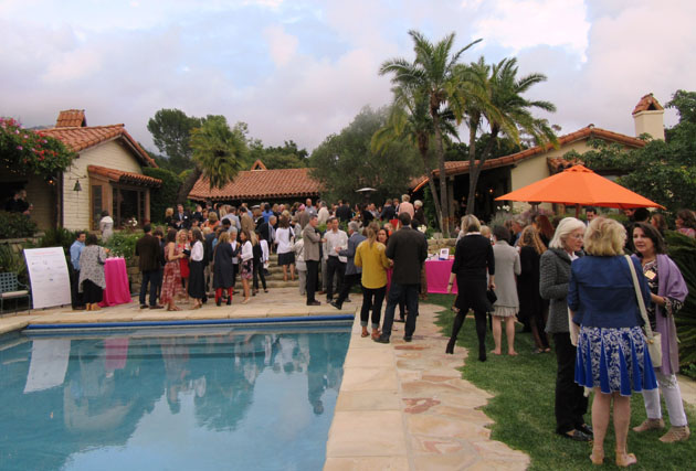 The hundreds of guests spill out to the pool area prior to the program.