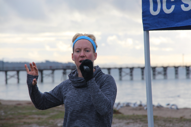 Fitness guru Jenny Schatzle addresses the running group in preparation for the race.