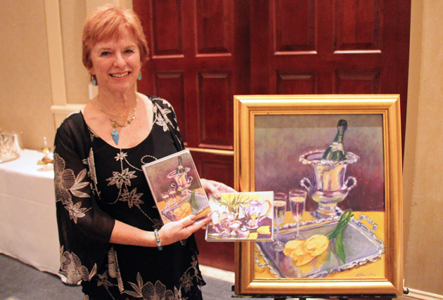 Suzy Hamilton with painting and program cover artwork for the DVS High Esteem Tea.