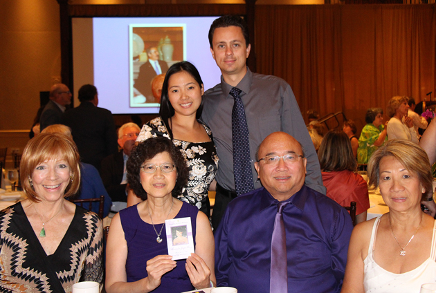 Front row from left, Liz Sekula, Elizabeth Tang, Alexander Tang and Clarice Yee; back row from left, Candice Tang Nyholt and Josh Nyholt. Elizabeth Tang is holding a photo of the late Alexandra Tang.