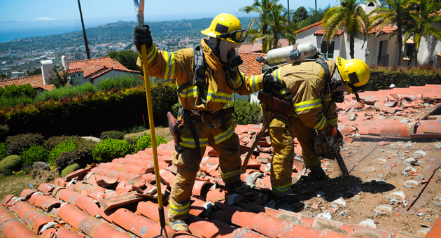 Rookie firefighters test their skills during a drill Tuesday at a home on Santa Barbara's Riviera. (Lara Cooper / Noozhawk photo)