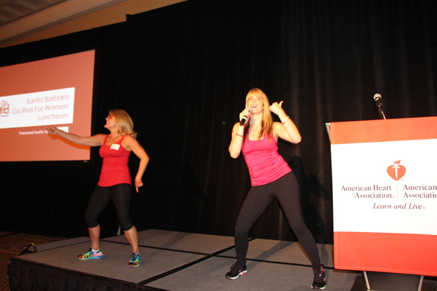 Jazzercise duo rev up the crowd during a dance exercise at the Go Red for Women luncheon.