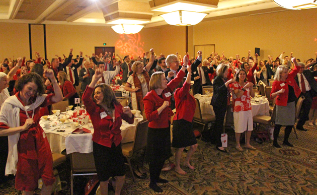 Guests burn some calories during a Jazzercise challenge at the Go Red for Women luncheon designed to encourage daily exercise.