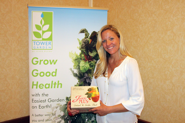 Maria Arroyo of Tower Garden hands out Juice Plus snacks to guests during the Health Expo.