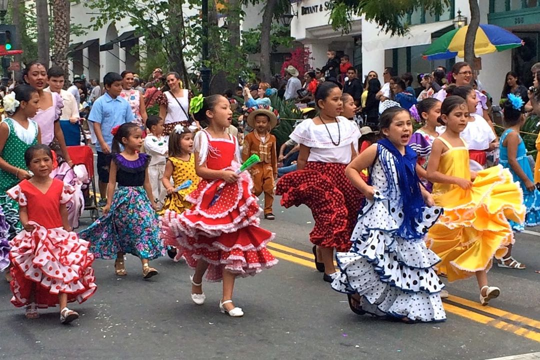Children dressed in colorful attire showed off their Old Spanish Days Fiesta song-and-dance routines as they paraded down State Street during Saturday's El Desfile De Los Niños.