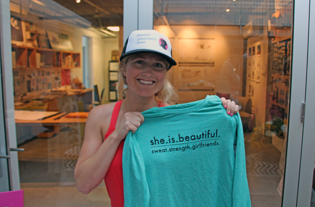 Melissa McConville, founder and director of She Is Beautiful, the Pinkest 5k and 10k run, shows off the latest gear.