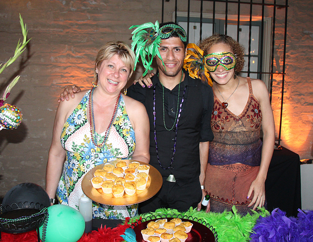 Chef Brenda Simon, left, Ben Cortes and Xena Densmore of The Secret Ingredient offered spicy cheese and bacon muffins to eager guests.