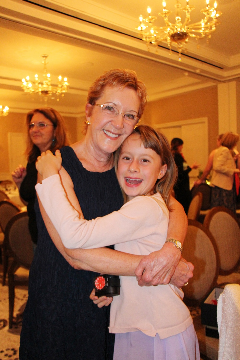 Honoree Mary Becker with her granddaughter, Tallulah Downs.