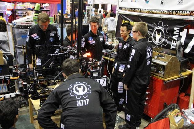 Members of Team 1717 discuss adjustments to their robot during a break in the action Saturday in Long Beach. (Brianna Doyle photo / Dos Pueblos Engineering Academy)
