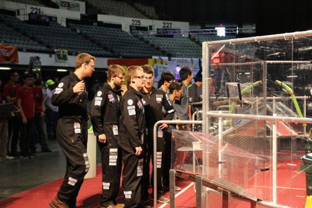 The DPEA robot drivers prepare their strategy before a key quarterfinal match. (Brianna Doyle photo / Dos Pueblos Engineering Academy)