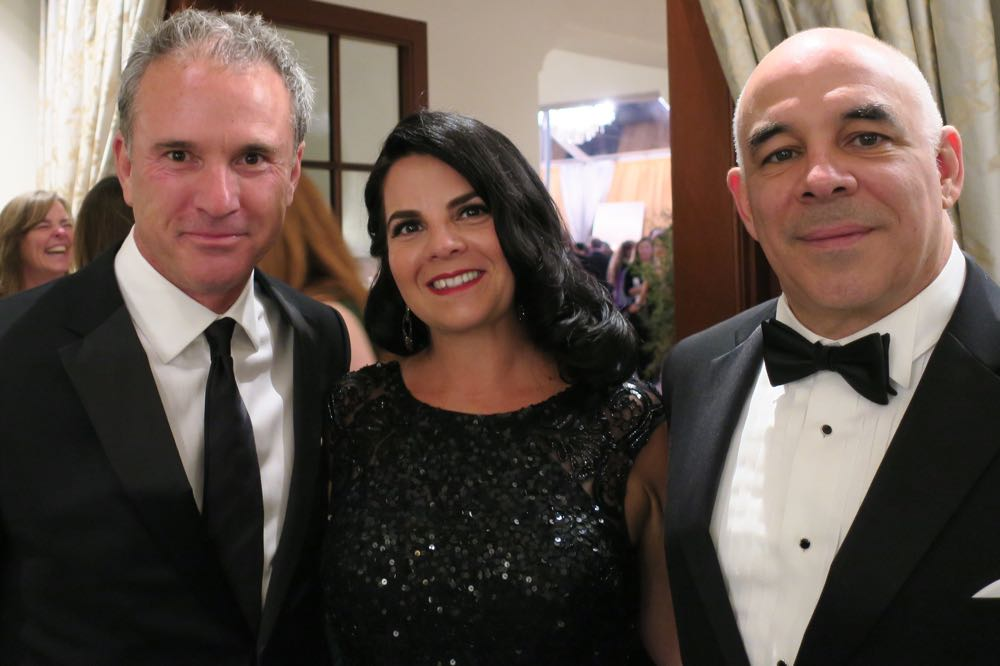 Direct Relief president and CEO Thomas Tighe, left, with Dr. Carlos Nunez, senior vice president of medical affairs at BD, a platinum sponsor of the Santa Barbara Wine Auction, and his wife, Elizabeth.