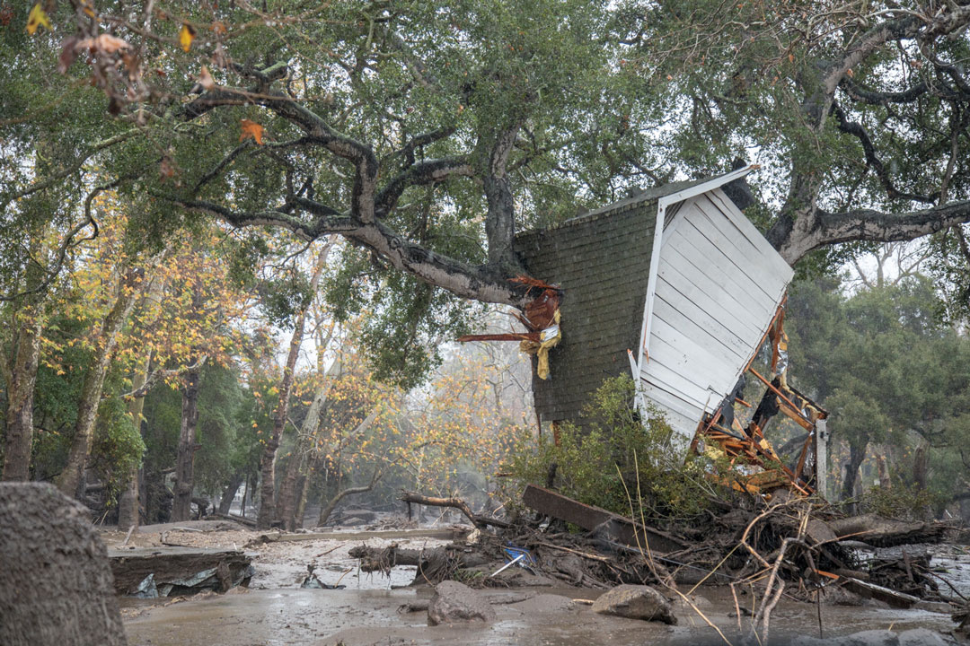 Part of a home ended up in a tree after Tuesday's flooding in Montecito.