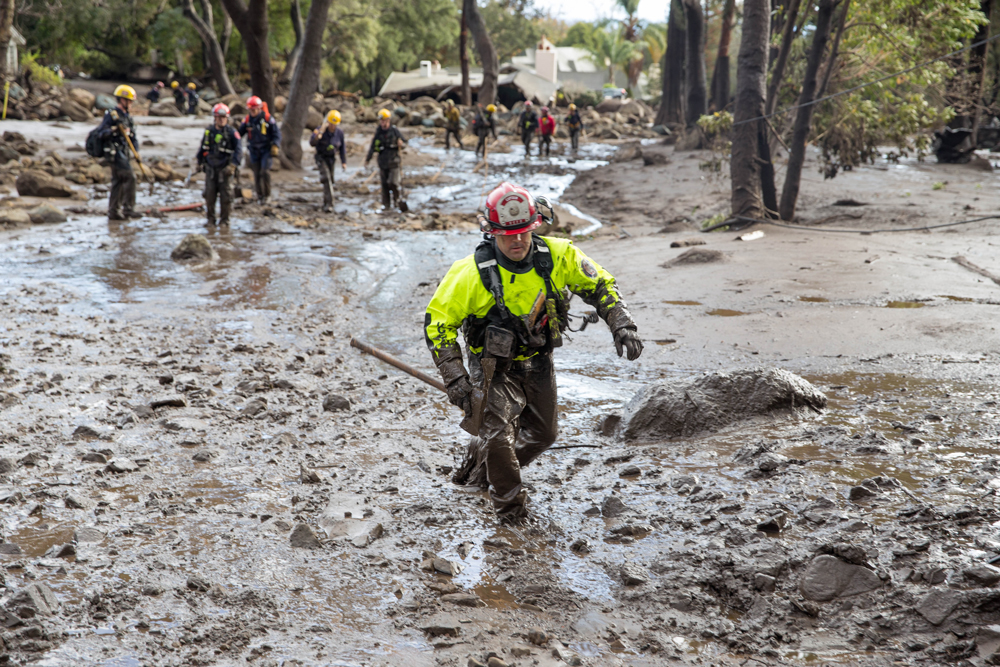 Rescue crews hoof it through the mud in Montecito.